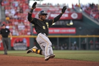 Pirates lose to Reds, 2-1, in extra innings